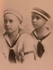 Two boys in sailor outfits
